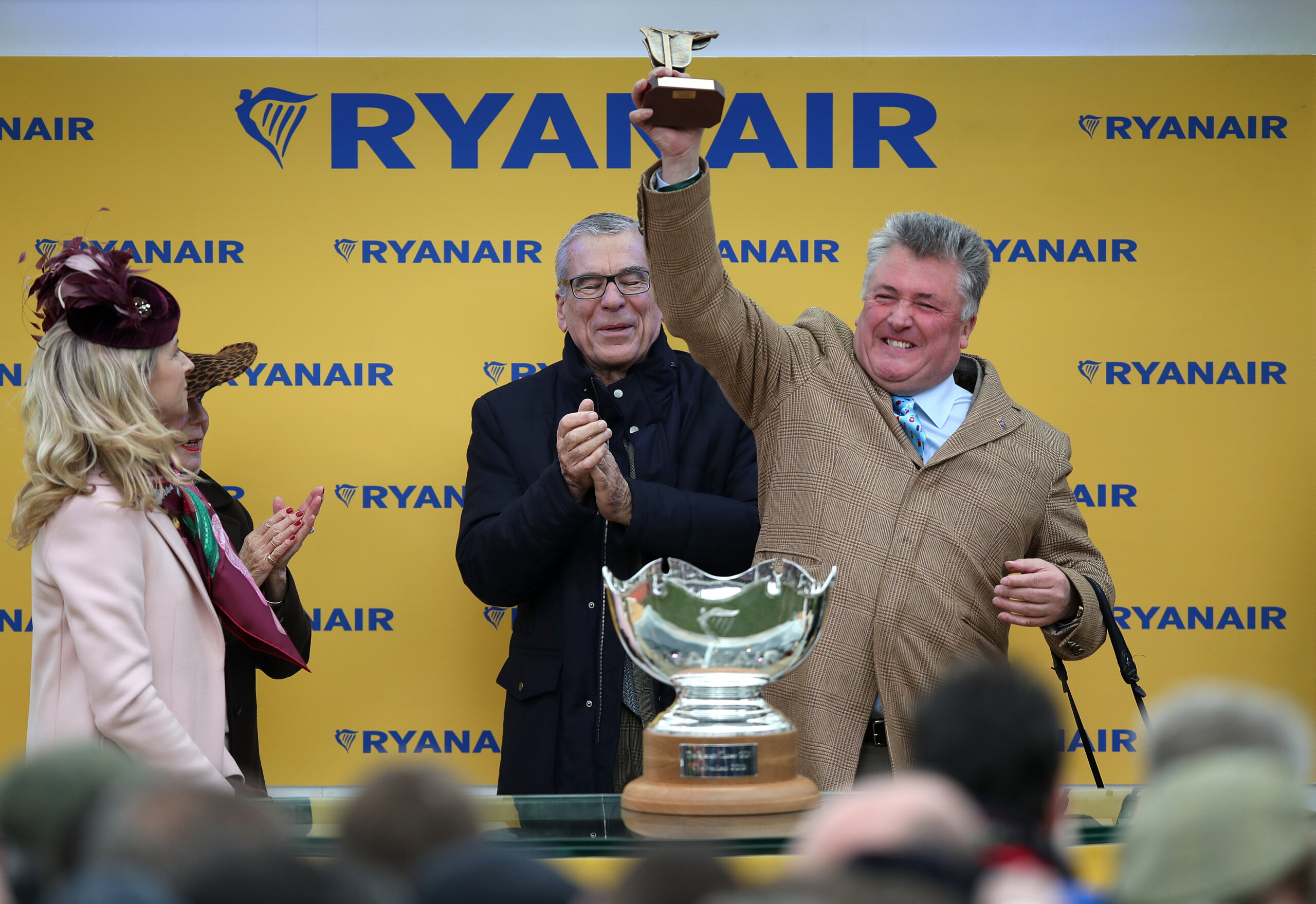 Champion Trainer Paul Nicholls Celebrates Ryanair Chase Victory with Frodon